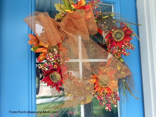 finished autumn wreath hanging on our blue front door