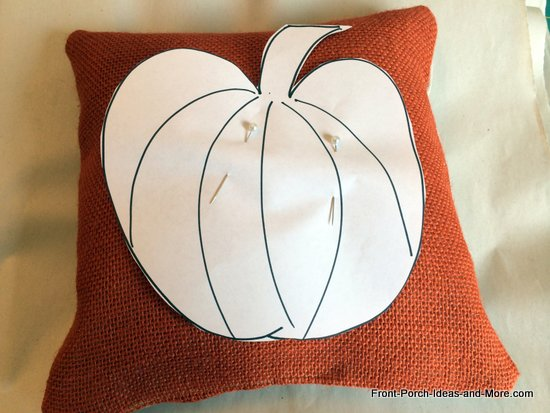 Pin the pumpkin template to the pillow.
