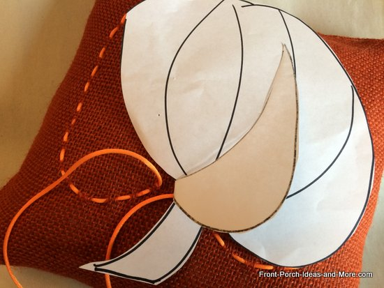 weaving ribbon into a pumpkin shape using the template as a guide