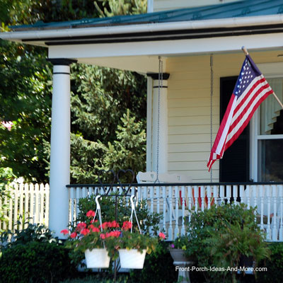 curb appealing country porch with American flag