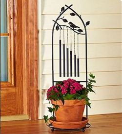 standing wind chime holds a plant