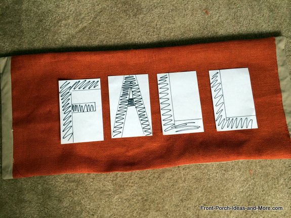fall porch swing cushion - use sheets of paper to make the letters