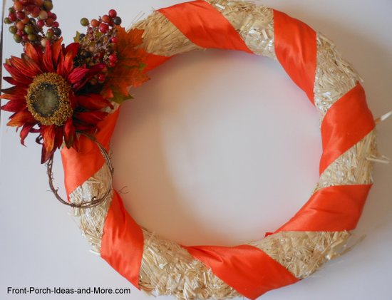 add flower decorations to the wreath