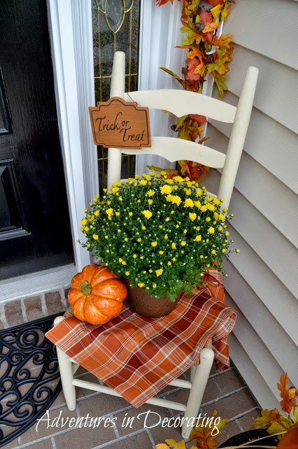 Ladderback chair decorated for autumn on front porch - by Adventures in Decorating