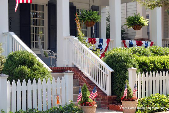 4th of July decorations behind white picket fence