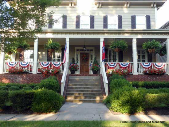 expansive front porch decorated for 4th of July