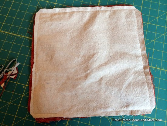 hem around the burlap and leave an opening to turn, trim the corners before turning