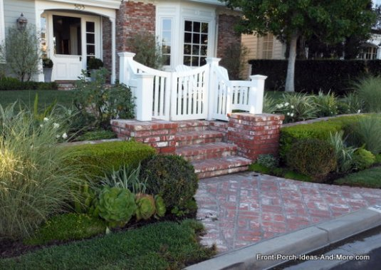 oval stone front porch steps on open front porch