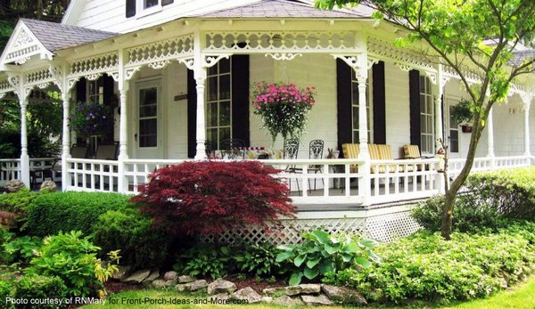 Elegant wraparound porch on this country style home