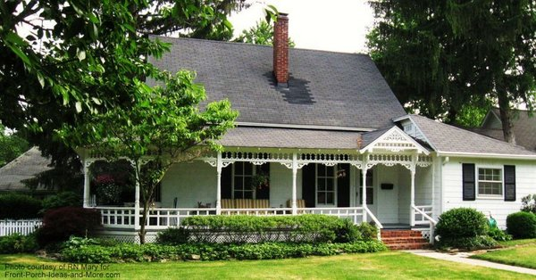 Another perspective of this elegant wraparound porch on this country style home