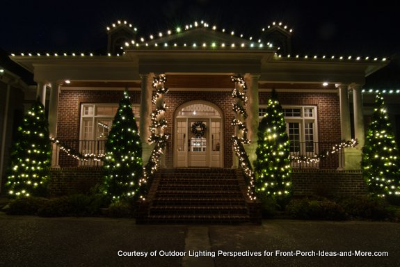 home outlined in beautiful christmas lights