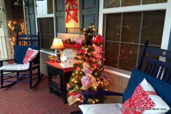 front porch decorated for christmas with railing lights