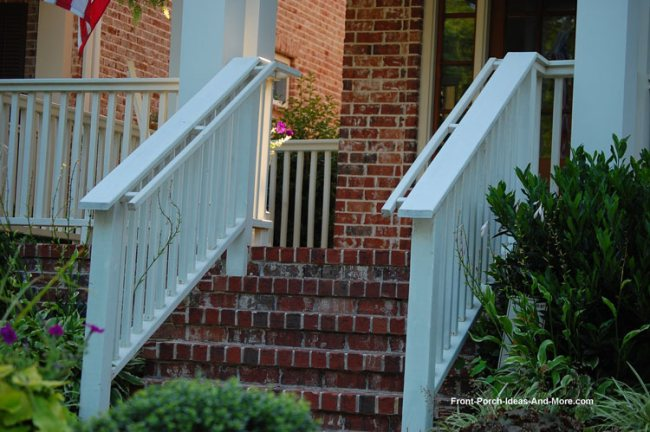porch stair hand rails and beautiful landscaping