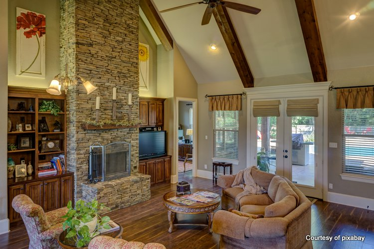 Tall and majestic stone fireplace with narrow mantel shelf