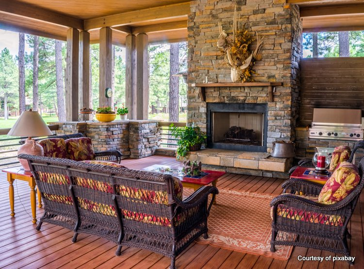 Beautiful screened porch with stone fireplace