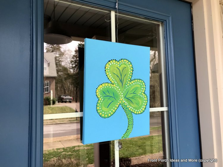 St. Patrick's Day shamrock on blue front door