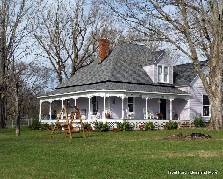 Lovely wraparound porch on this beautiful country home