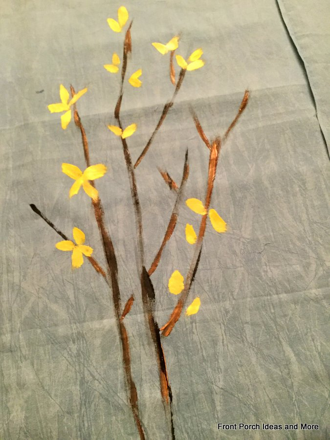 forsythia branches painted onto fabric with acrylic paints and then a few yellow blossoms added