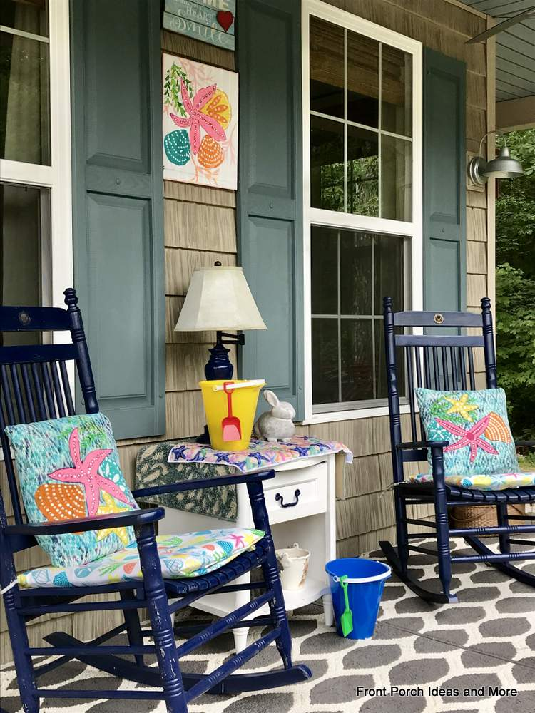 Summery beach cushions and shells painted on pillows