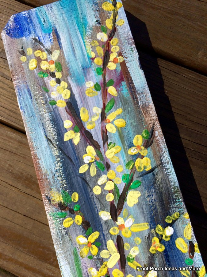 Close-up of forsythia wall art for our spring porch