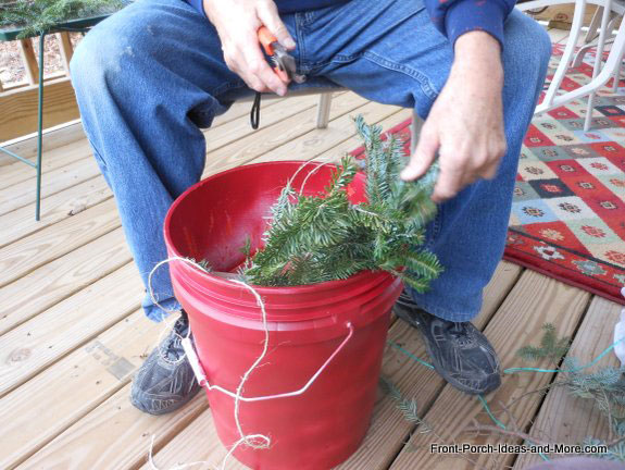 placing greenery around the inside edge of a bucket