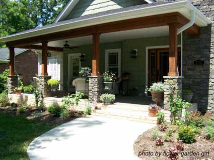 Craftsman style porch with stone pedestals