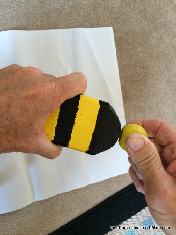 attaching the bumble bee head onto the bumble bee decoration