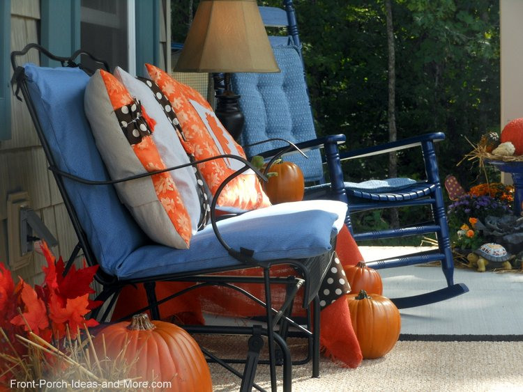 autumn decorated front porch in blue and oranges