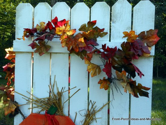 leaf garland on autumn fence craft