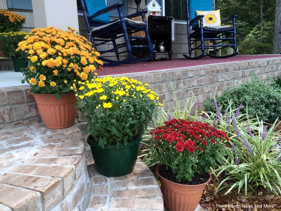 Dress up your porch steps for autumn so easily with pots of mums.