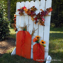 autumn craft with picket fence and pumpkins