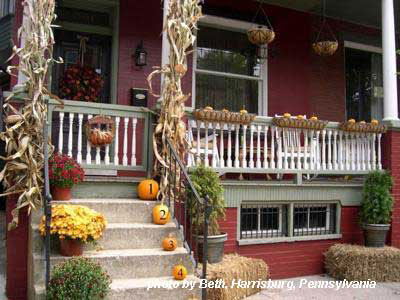 porch steps lined with numbered pumpkins