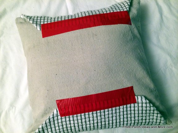 Back of pillow enclosed in tea towel and fastened with duct tape