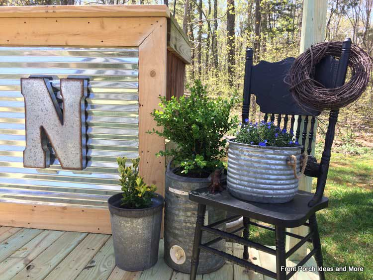 Corrugated roofing metal and galvanized buckets interplay with each other to personalize their deck