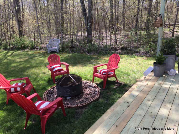A DIY firepit and several comfortable adirondack chairs make for a nice conversation setting