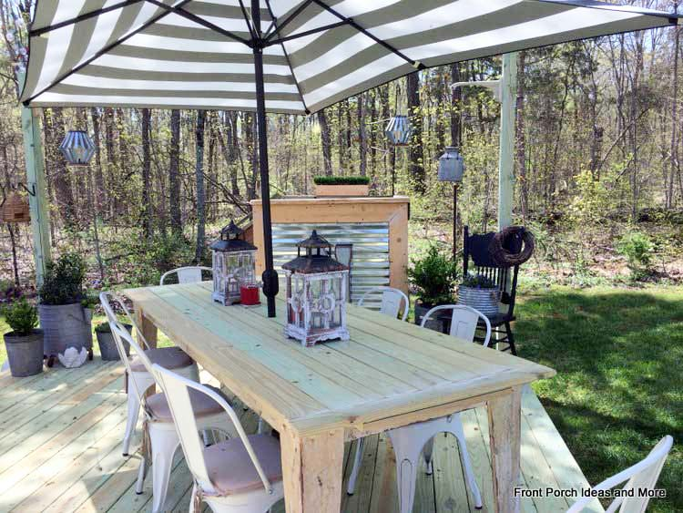 Backyard table with a rectangular shaped umbrella seats a good sized group for a picnic