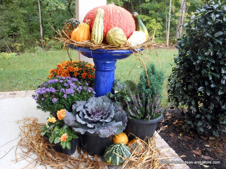 thanksgiving porch decorating idea using birdbath and gourds