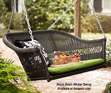 black resing wicker porch swing on patio