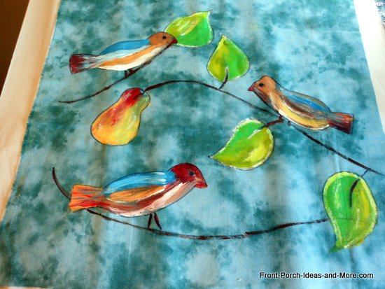 bird drawing onto blue fabric - painting done