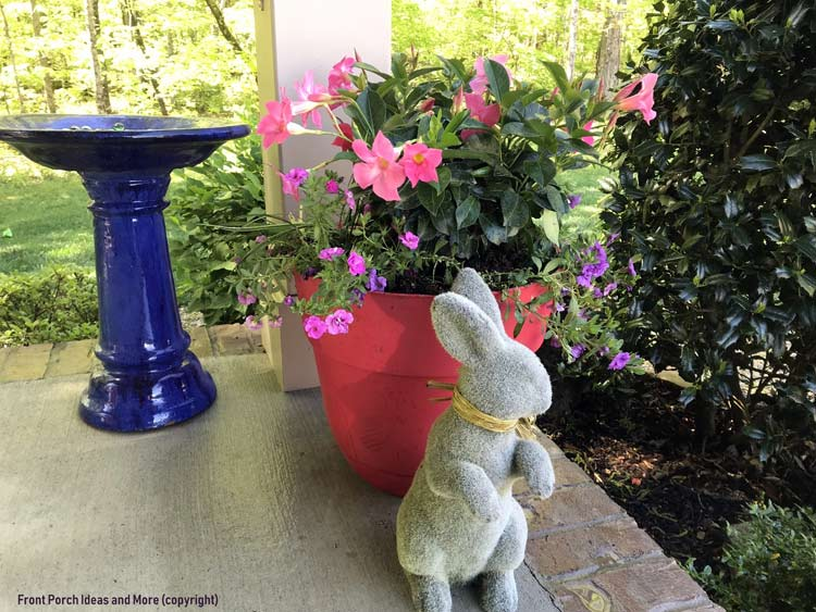 a corner of our porch with pretty plants and a bunny
