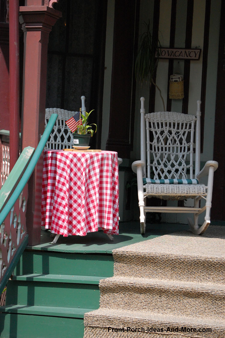 partially carpeted front porch steps on charming front porch