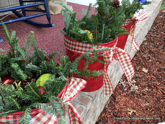 holiday decorative buckets with greenery