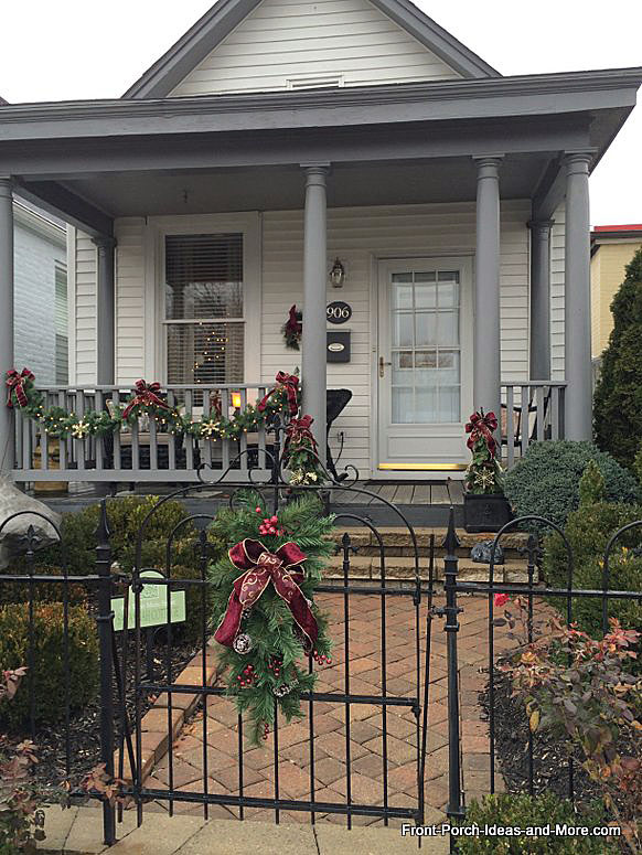 simple evergreen garland and bows on porch railings for christmas in madison indiana