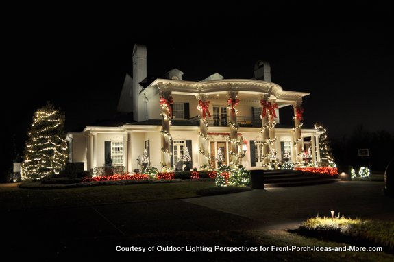 Beautiful home lit with holiday lights