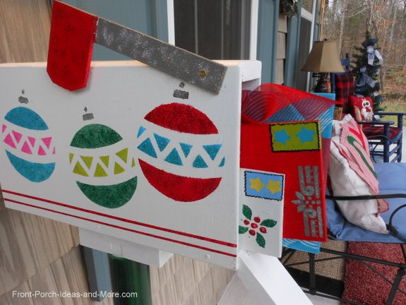 Christmas mailbox decoration on front porch complete with letters and gifts