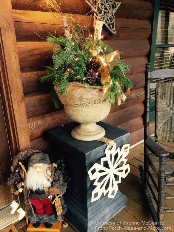 Yvonne's log cabin porch decorated for Christmas