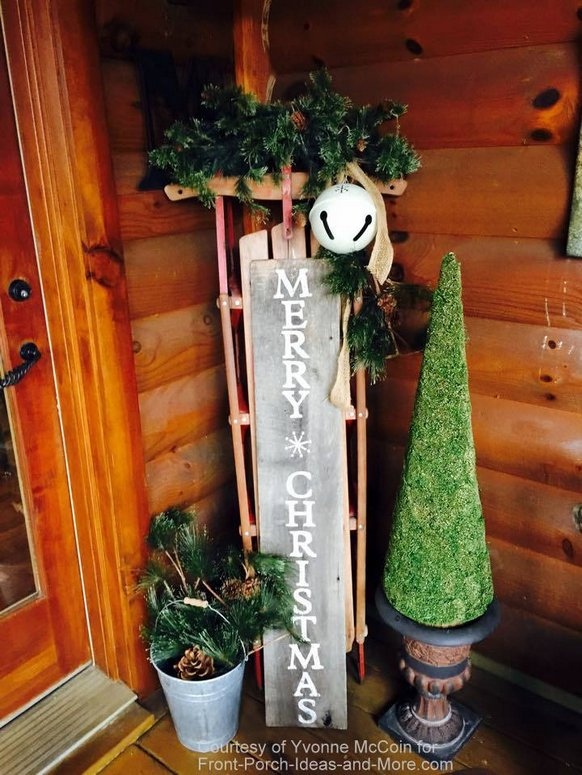 yvonnes log cabin porch decorated for christmas