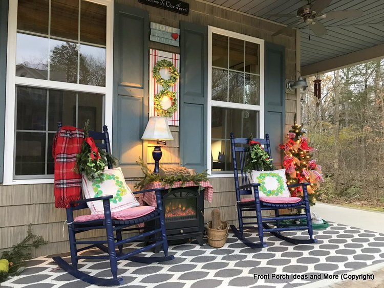 Christmas porch with boxwood wreaths and Christmas tree