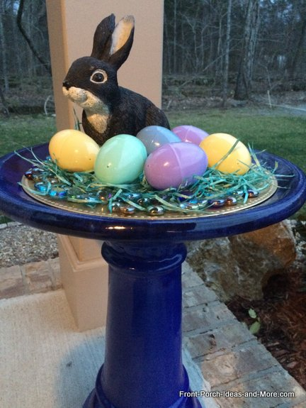 Cobalt blue bird bath decorated for spring