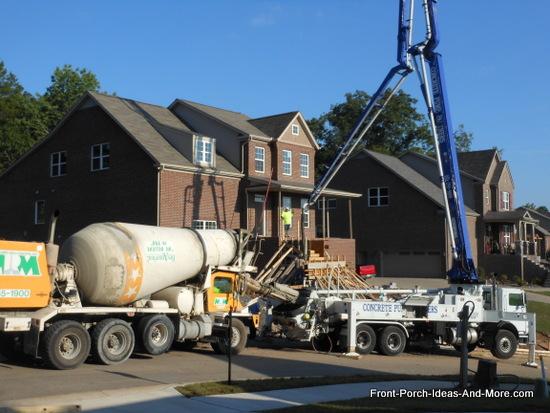 concrete truck delivering concrete to the concrete pumping truck